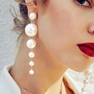 Long pearl gold earrings brand new.